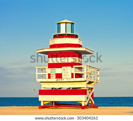 Miami Beach Florida, USA famous tropical travel location, typical Art Deco lifeguard house on a beautiful summer afternoon with ocean and blue sky  - stock photo