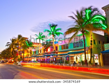 Miami Beach, Florida USA-November 10, 2015: Moving traffic, Illuminated hotels and restaurants at sunset on Ocean Drive, world famous destination for nightlife, beautiful weather, Art Deco and beaches
