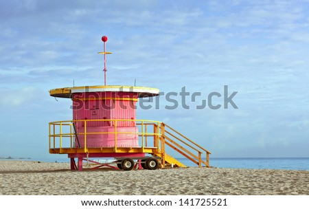 Miami Beach, Florida USA typical Art Deco lifeguard house in pink color on a beautiful summer day with blue sky and ocean in the background