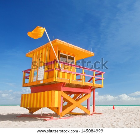 Miami Beach Florida, yellow lifeguard house in typical Art Deco architecture during summer day with blue sky - stock photo
