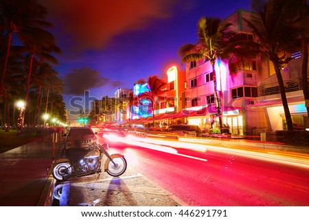 Miami Beach South Beach sunset in Ocean Drive Florida Art Deco and car lights - stock photo