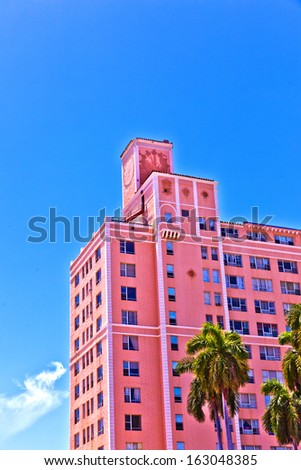 MIAMI BEACH, USA - AUGUST 02: midday view at Washington Avenue on August 02,2010 in Miami Beach, Florida. Art Deco architecture in South Beach is one of the main tourist attractions in Miami. - stock photo