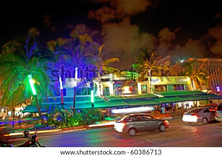 MIAMI BEACH, USA - AUGUST 02: Night view at Ocean drive on August 02,2010 in Miami Beach, Florida. Art Deco Night-Life in South Beach is one of the main tourist attractions in Miami. - stock photo