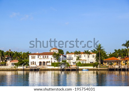 MIAMI BEACH, USA - JULY 31, 2010: luxury houses at the canal in Miami Beach, USA. Pinetree Drive is the premier neighborhood for luxury homes. - stock photo
