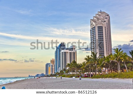 Miami beach with skyscrapers - stock photo