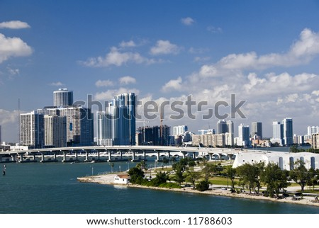 miami city skyline with bridge in middle and water in foreground
