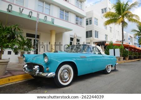 MIAMI - DEC 24: 1957 Ford Thunderbird in front of Art Deco style Avalon Hotel in Miami Beach on December 25th, 2012 in Miami, Florida, USA - stock photo