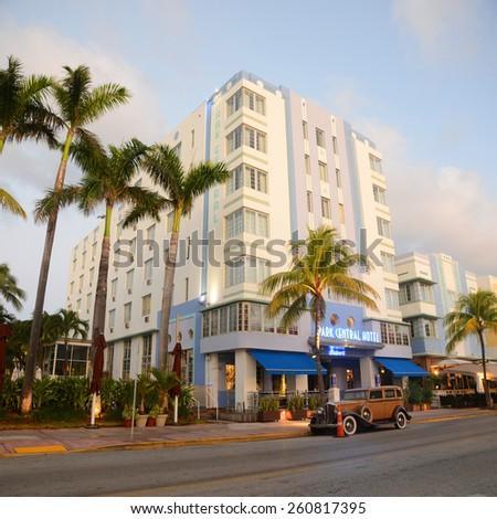 MIAMI - DEC 25: Park Central with Art Deco Style Building and antique Car in Miami Beach on December 25th, 2012 in Miami, Florida, USA. - stock photo