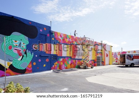 MIAMI - DECEMBER 03: Art Murals at Wynwood December 03, 2013 in Miami, USA.Wynwood is a neighborhood in Miami Florida which has a strong art culture presence and murals can be seen everywhere. - stock photo