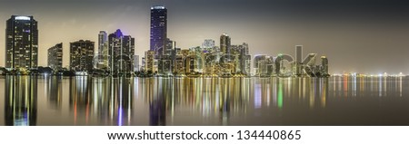 Miami downtown panorama by night illuminated by business and luxury residential buildings in Florida - stock photo