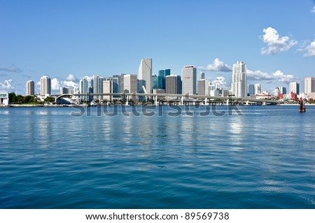 Miami Downtown skyline in daytime with Biscayne Bay. All logos and brand names of building removed. - stock photo