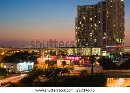 Miami Elevated Commuter Train Tracks, Streets, Buildings and Traffic at Sunset - stock photo
