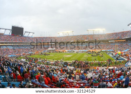 MIAMI - FEB 4: People gather for Super Bowl XLI between the Indianapolis Colts and Chicago Bears at Dolphins Stadium on February 4, 2007 in Miami, Florida. - stock photo