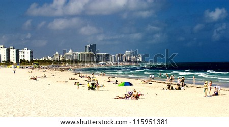 MIAMI - FEB 26: People relax in South Beach Area, February 26th, 2011 in Miami, Florida. This area was the first section of Miami Beach to be developed, starting in the 1910s. - stock photo