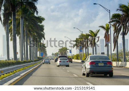 MIAMI - FEBRUARY 6, 2012: Cars speed up on MacArthur Causeway along the sea. Construction on the roadway began in 1917 and was completed in 1920 - stock photo