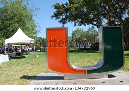 "MIAMI, FL - APRIL 6: A tent is set up for the American Cancer Society Relay for Life event near the ""U"" sculpture on the University of Miami campus in Coral Gables, Florida on April 6, 2013. - stock photo"