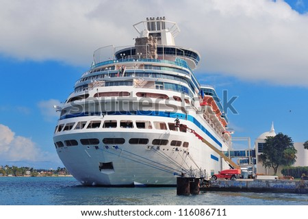 MIAMI, FL - FEB 10: Cruise Ship at Miami Port with blue clear sky on February 10, 2012 in Miami, Florida. The port is the 11th largest cargo port in the US. - stock photo