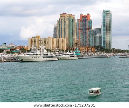 MIAMI, FL - JAN 21, 2013:Miami Beach buildings and marina with luxury yachts on January 21, 2013. Famous travel location - stock photo