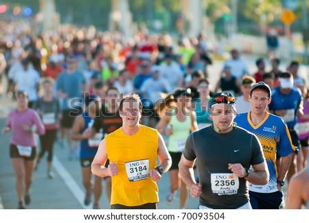 MIAMI, FL - JANUARY 30: Unidentified competitors run during the Miami Marathon on January 30, 2011 in Miami, Florida. - stock photo