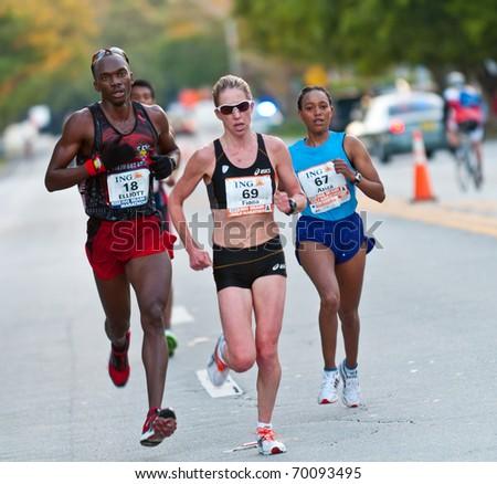 MIAMI, FL - JANUARY 30: Unidentified runners compete during the Miami Marathon on January 30, 2011 in Miami, Florida. - stock photo