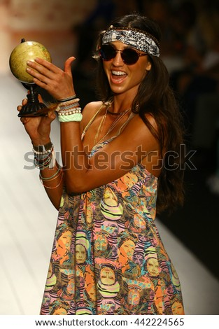 MIAMI, FL - JULY 19: A model walks runway in designer swim apparel during the Maaji Swimwear fashion show at W hotel for Miami Swim Week on July 19, 2015