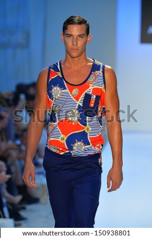 MIAMI, FL - JULY 21: A model walks the runway at the A.Z. Araujo show during Mercedes-Benz Fashion Week Swim 2014 at Oasis at the Raleigh on July 21, 2013 in Miami, Florida.  - stock photo