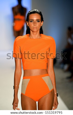 MIAMI, FL - JULY 19: A model walks the runway at the Suboo show during Mercedes-Benz Fashion Week Swim 2014 at Oasis at the Raleigh on July 19, 2013 in Miami, Florida. - stock photo