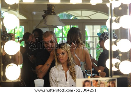 MIAMI, FL - JULY 20: A modelgetting ready backstage at the Beach Bunny Swimwear fashion presentation at Sunset Island for Miami Swim Week on July 20, 2016