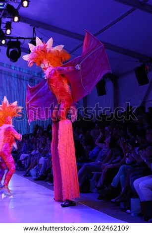 MIAMI, FL - JULY 20:  Dancers perform on the runway at the Luli Fama during MBFW Swim 2015 at The Raleigh hotel on July 20, 2014 in Miami, FL.