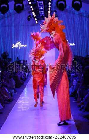 MIAMI, FL - JULY 20: Dancers perform on the runway during Luli Fama show at Luli Fama during MBFW Swim 2015 at The Raleigh hotel on July 20, 2014 in Miami, FL.
