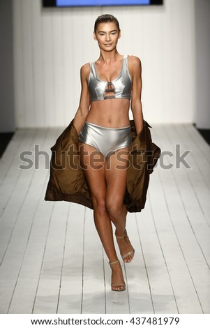 MIAMI, FL - JULY 16: Models grace the catwalk in designer swim apparel during the Art Institute's fashion show for Miami Swim Week on July 16, 2015