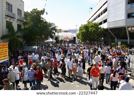 """MIAMI, FL - MARCH 13: A crowd of people gathered at the """"Calle Ocho Carnival"""" March 13, 2005 in Miami Florida. - stock photo"""