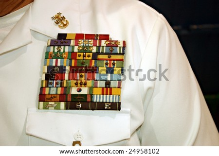 Miami, FL - March 17: An unidentified Master Chief Petty Officer of the Navy shows his military award ribbons such as Purple Heart, Presidential Unit, Korea & Vietnam March 17, 2005 in Miami, Florida. - stock photo
