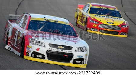 MIAMI, FL - Nov 16: Kevin Harvick (left) leading Joey Logano (right) at the Nascar Sprint Cup Ford Ecoboost 400 race at Homestead-Miami Raceway in Homestead, FL on November 16, 2014