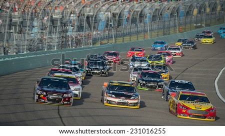 MIAMI, FL - Nov 16: Three wide at the Nascar Sprint Cup Ford Ecoboost 400 race at Homestead-Miami Raceway in Homestead, FL on November 16, 2014