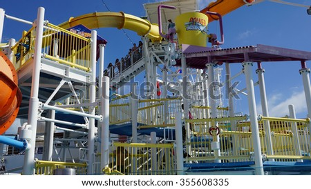 MIAMI, FL - NOV 1: Water slides on the Carnival Breeze docked in Miami, Florida, on Nov 21, 2015. The Breeze is a Dream-class cruise ship owned by Carnival Cruise which entered service in June 2012. - stock photo