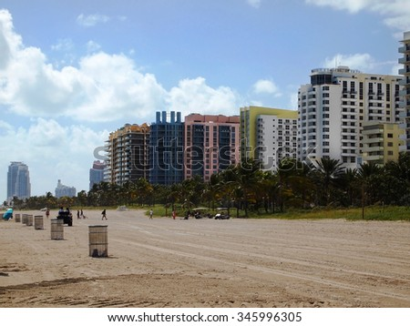 MIAMI, FL - NOVEMBER 11, 2012:  A row of art deco style hotels in pastel colors lines the beach in the South Beach area of Miami, Florida, USA. - stock photo