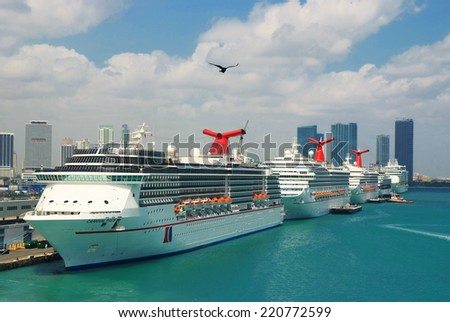 Miami, FL, USA- November 7, 2008: Cruise ships docked in Miami port. Miami port one of the biggeest passanger port in USA. In the front of this picture the Carnival Ships.  - stock photo