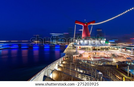 "MIAMI, FLORIDA - 6 AM. AUGUST 5, 2007: Carnival ""Valor"" cruise ship is docking in the central cruise terminal. Over 3,000 guests are returning after 7 days voyage. - stock photo"