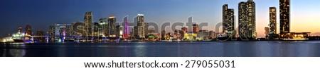 Miami, Florida, 5. April 2014 - Miami city skyline panorama at dusk with urban skyscrapers and bridge over sea. - stock photo