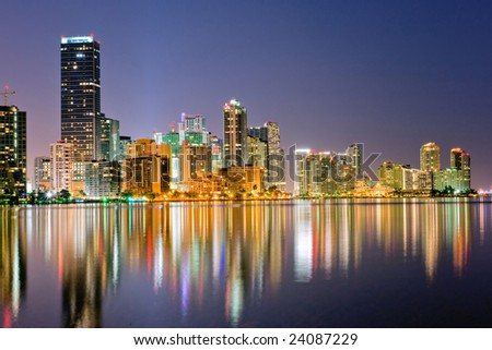 miami florida bayfront  skyline at dusk with lights shimmering in water, 2009 - stock photo