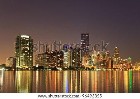 Miami Florida bayfront skyline at night (actual reflections in water) - stock photo