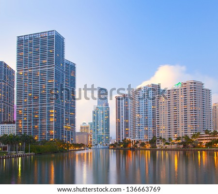 Miami Florida, Brickell and downtown financial buildings over miami River on a beautiful summer day before sunset - stock photo