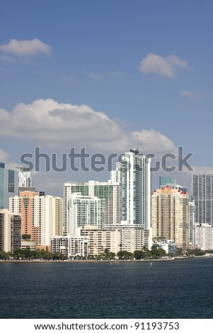 Miami Florida, downtown residential and office buildings and hotels, with Biscayne bay waters and blue sky on a beautiful sunny day. Famous travel location.