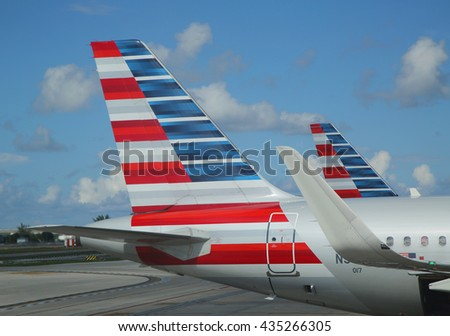 MIAMI, FLORIDA - JUNE 1, 2016: American Airlines tailfin at Miami International Airport. American Airlines operates 274 flights every day from Miami