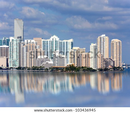 Miami Florida panorama of downtown residential and office buildings and hotels, with Biscayne bay water reflections and colorful sky on a beautiful day. Famous travel location - stock photo