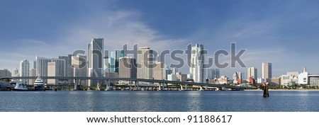 Miami Florida panorama of downtown residential and office buildings and hotels, with Biscayne bay waters and blue sky on a beautiful sunny day. Famous travel location. - stock photo