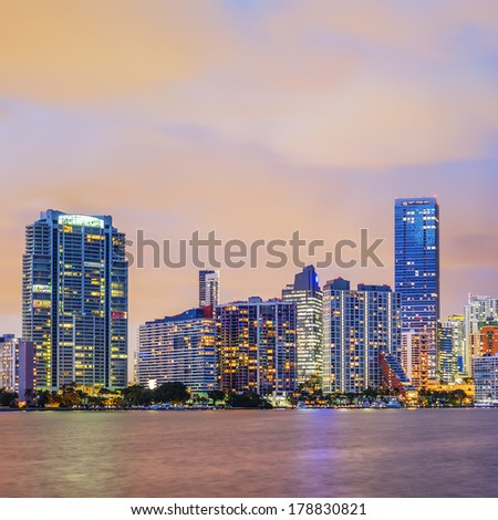 Miami Florida, summer sunset with colorful illuminated business and residential buildings and bridge on Biscayne Bay  - stock photo