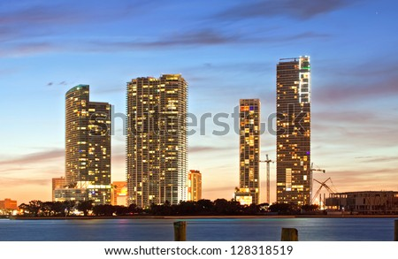 Miami Florida sunset over downtown illuminated business and luxury residential buildings and hotels on Biscayne Bay. Night Cityscape of World famous travel location. - stock photo