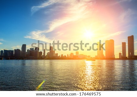 Miami Florida, sunset  with colorful illuminated business and residential buildings  - stock photo